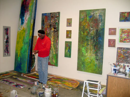 Winston Branch painting in his Studio